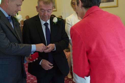 Exchange of rings wedding photograph