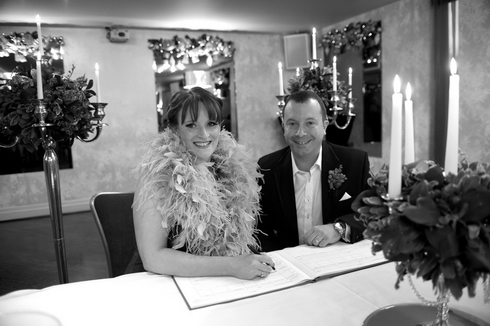 Signing the register at The Vincent Hotel