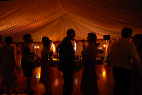 Wedding party and evening guests dance the night away