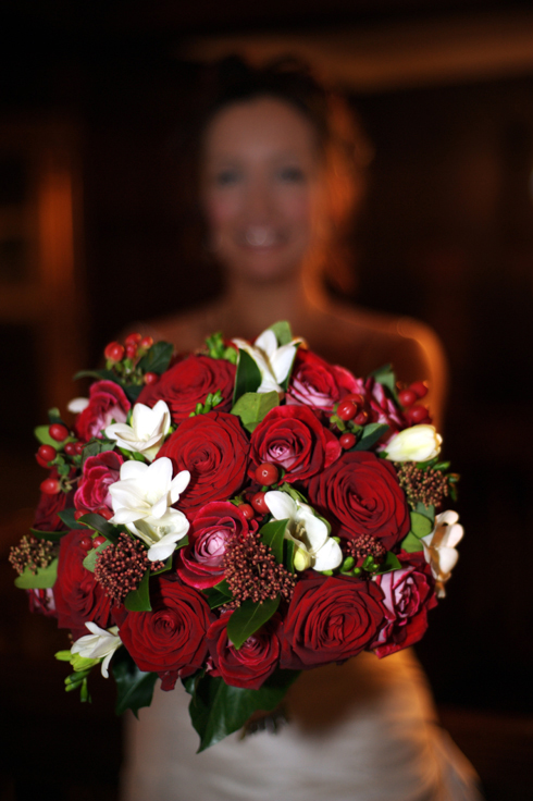 bride with her wedding flowers by professional photographer David J Colbran