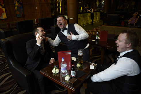 Grooms party preparations in the bar